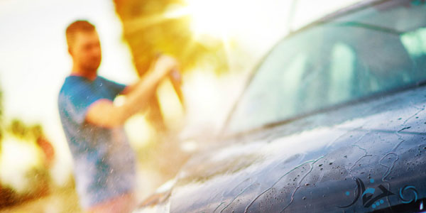 picture-of-man-washing-off-car